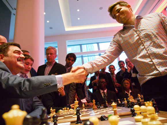 World chess champion Magnus Carlsen at a First Move chess event - event photography in New York City by Happening Photos