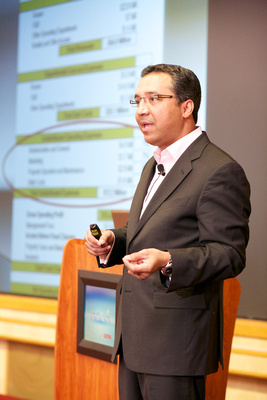 Speaker presentation at MPI educational event. Event photography in New York. Photo by Happening Photos.